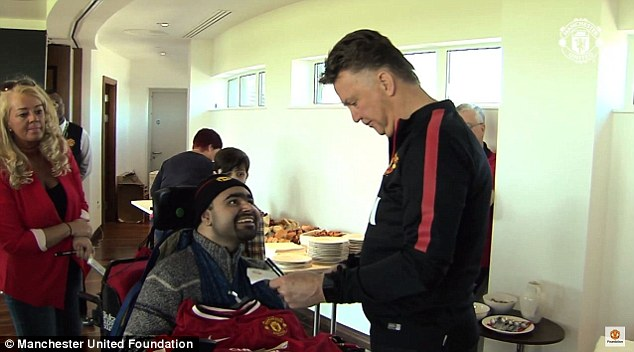 Van Gaal reads the carefully written document containing the names of who he 'should' bring to Old Trafford
