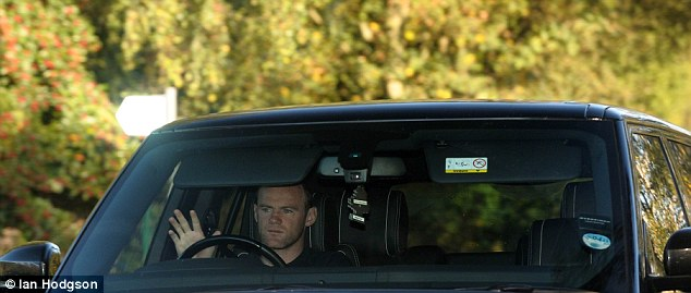 The England captain was seen here driving his £100,000 Overfinch Range Rover to training at Carrington