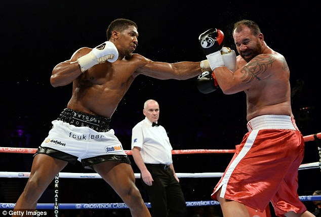 Anthony Joshua (left) beat Jason Gavern (right) last time out and will now face Rafael Zumbano Love