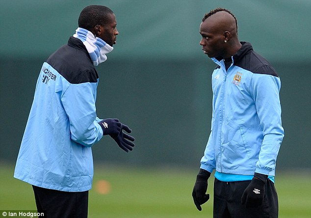 Toure (left) is a quiet figure away from the field and refuted reports of a fall-out with Mario Balotelli