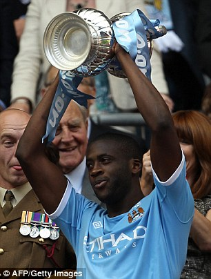 Toure lifts the FA Cup aloft after scoring in the final against Stoke