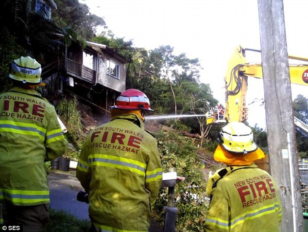 A firetruck had been brought in to dampen the house and the surrounding area as the property contained asbestos, which needs to be wet in order to prevent the toxic material becoming airborne