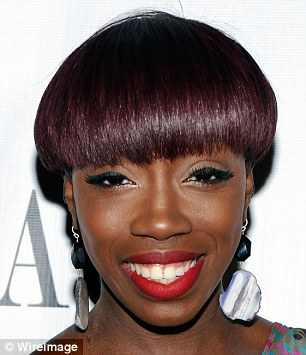 American Boy singer Estelle added a red tint to her bowl cut