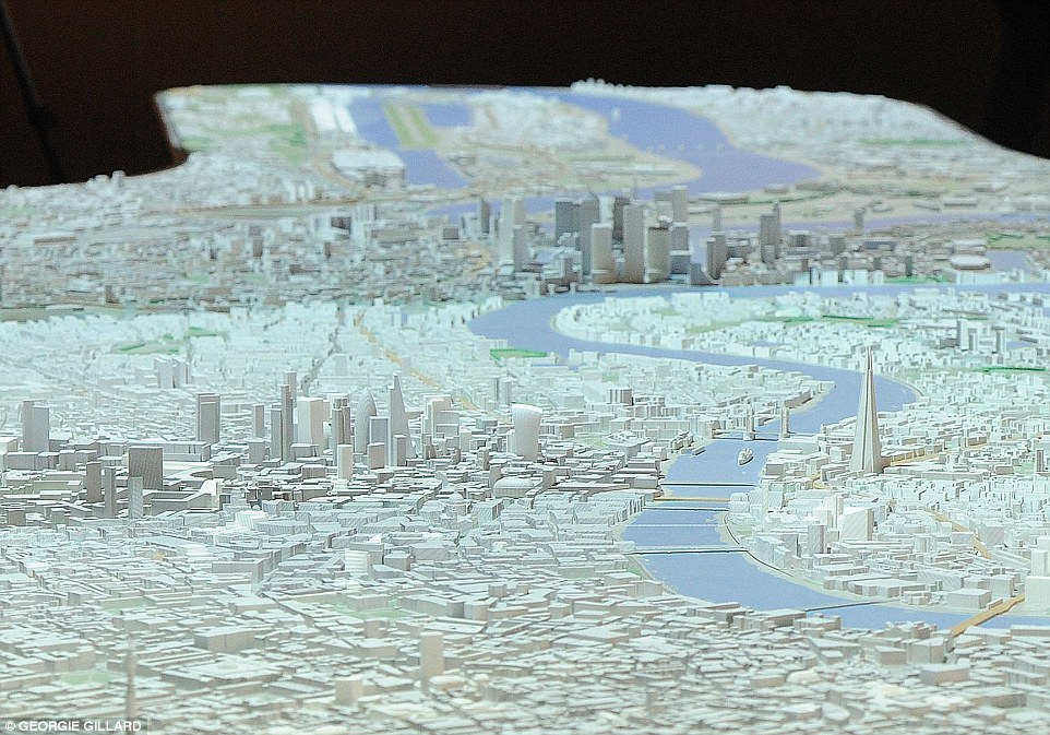 The 1:2000 scale New London Model covers 33 square miles (85 sq km) of London from Old Oak Common in the west to Royal Docks in the east, Nine Elms in the south to King's Cross and the site of London's 2012 Olympics in the north. The Shard is pictured to the right of the Thames with Canary Wharf out of focus in the background