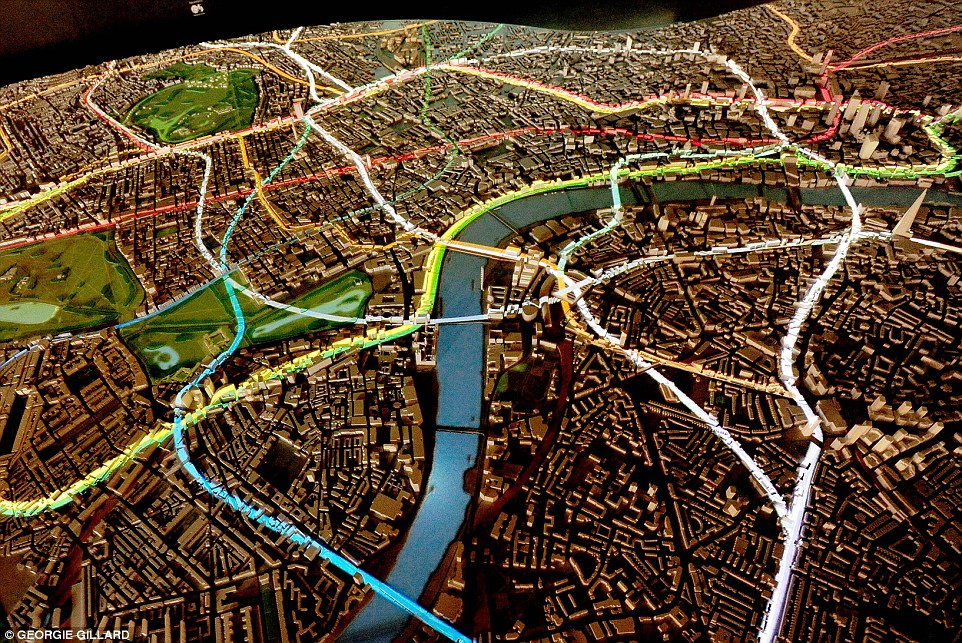 A projection system is used to beam lights that plot the location of various underground lines, for example, (pictured) highlight the boundaries of 19 of London's 32 boroughs, plus the City of London, and reveal how these boroughs have evolved over time