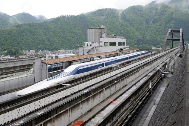The seven-car Maglev (pictured) - short for 'magnetic levitation' - hit a top speed of 375mph (603 km/h) and travelled for almost 11 seconds at speeds above 373mph (600km/h) during a run near Mount Fuji. It beat last week's speeds of 366mph (590kph), which in turn beat the train's previous record of 361mph (581km/h)