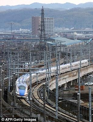 "The new Hokuriku ""shinkansen"", or bullet train, bound for Tokyo heads out of Kanazawa station in Ishikawa prefecture on March 14"