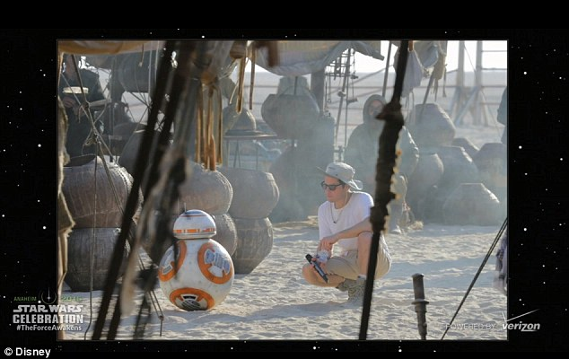 BB-8's body is a spherical ball that allows it to move in any direction, but it also has a completely free-moving head that doesn't fall off, leaving applauding spectators wondering how it works. This image shows the robot on the set of the film, which will be released in the UK in December