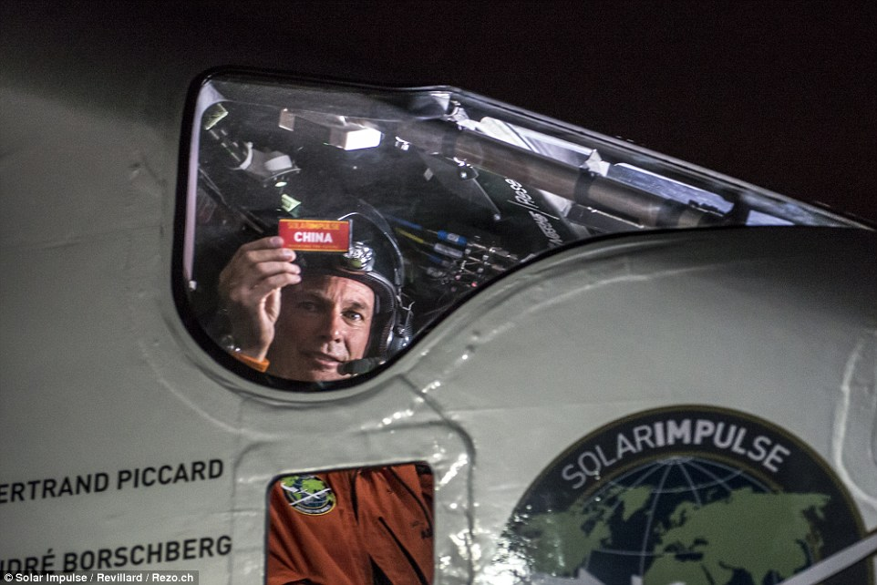 The plane touched down in Chongqing with Swiss pilot Bertrand Piccard at the controls (shown) on 31 March, and was expected to take off the following day towards Nanjing, North West China