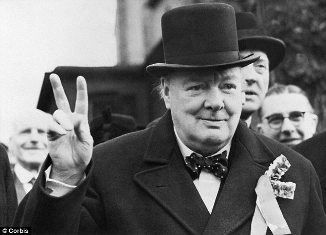 Winston Churcill is pictured gives his 'victory' sign as, wearing his famed Curchillian hat, he made a polling day tour of his constituency during the election in 1945. Churchill was the Conservative candidate for Woodford, Essex, but lost in the elections
