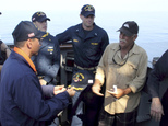 ATTN SHOUN HILL In this Dec. 9, 2014 photo released by the U.S. Navy, Cmdr. John Barsano, commanding officer of the guided-missile destroyer USS Paul Hamilton welcomes Ron Ingraham, right, aboard Paul Hamilton in the Pacific Ocean after Ingraham was stranded at sea without food or water. The Coast Guard says it is searching for Ingraham, a mariner off Hawaii who last year survived 12 days lost at sea. (U.S. Navy photo via AP)