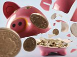 broken piggy bank showing coins coming out of he  piggy bank