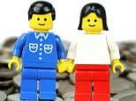 """Lego man and woman standing on coins - """"in the money"""" concept"""