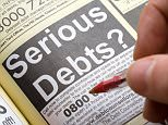 Serious Debts advertisement in Yellow Pages. AAJKR2  SERIOUS DEBTS AD ADVERTISEMENT FINANCIAL PERSONAL PROBLEMS YELLOW PAGES DIRECTORY CLOSE UP UK