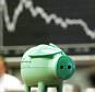 STOCK EXCHANGE...A small piggy bank is seen in the Frankfurt, western Germany, stock exchange on Thursday, Sept. 19, 2002. In background the board indicating the German stock index DAX, that fell close to the 3,000 point mark. (AP Photo/Michael Probst)...I F...FRANKFURT...DEU