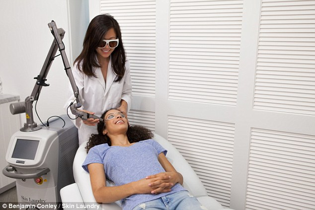 Skin spa: Clients of Skin Laundry's facial lay down while a nurse uses a laser and pulsing light on their skin
