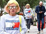Picture Shows: Lily Allen  April 24, 2015    British singer Lily Allen shows off her new neon hairstyle while out and about on Melrose with friends in Los Angeles, California. Lily debuted her new look on Instagram last week.    Non-Exclusive  UK RIGHTS ONLY    Pictures by : FameFlynet UK � 2015  Tel : +44 (0)20 3551 5049  Email : info@fameflynet.uk.com