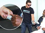 Beverly Hills, CA - Mark Wahlberg hands a hundred dollar bill to a homeless man as he heads to the valet for his car following lunch at E. Baldi with friends in Beverly Hills. The stand up actor slipped a $100 bill to the crippled gentleman in a wheelchair as he left the popular restaurant.\nAKM-GSI   April  23, 2015\nTo License These Photos, Please Contact :\nSteve Ginsburg\n(310) 505-8447\n(323) 423-9397\nsteve@akmgsi.com\nsales@akmgsi.com\nor\nMaria Buda\n(917) 242-1505\nmbuda@akmgsi.com\nginsburgspalyinc@gmail.com