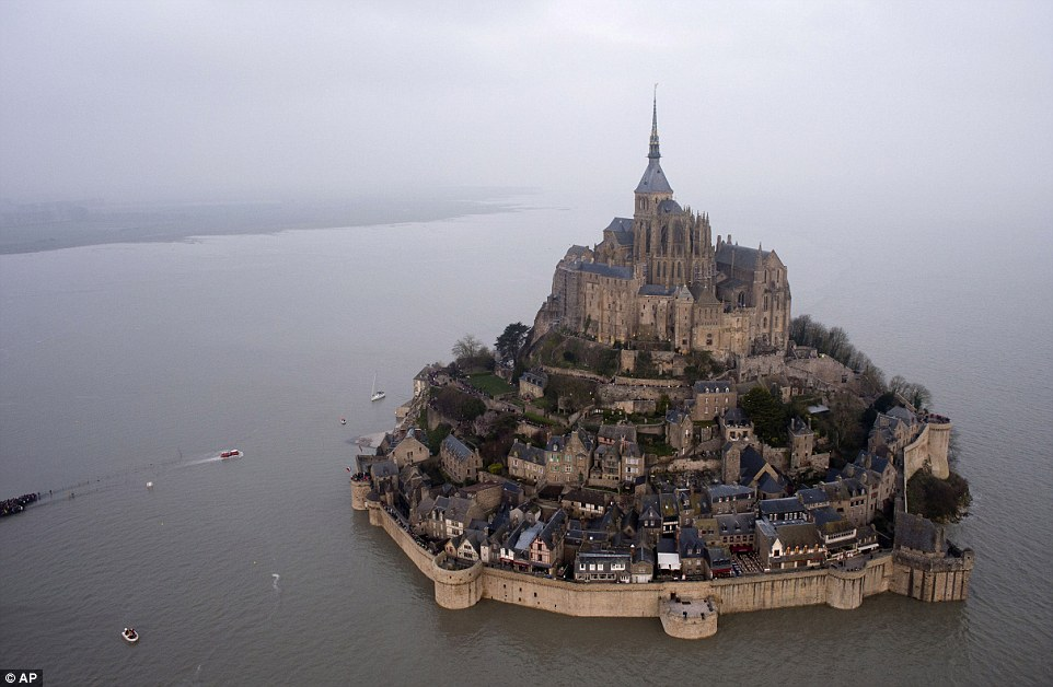 An aerial view as a high tide submerges a narrow causeway leading to Mont Saint-Michel in north-western France