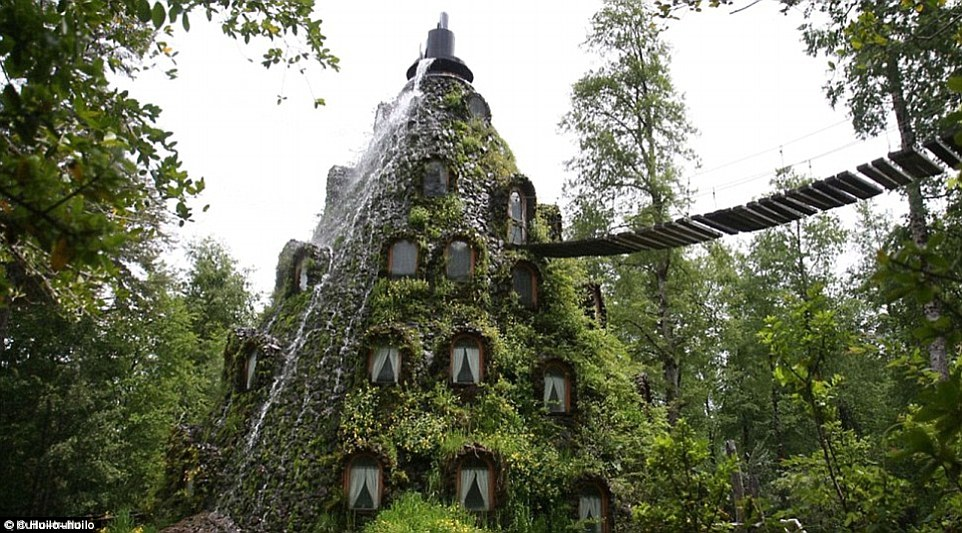 The Magic Mountain Lodge in the Chilean Patagonian Rainforest is a man-made structure with a waterfall