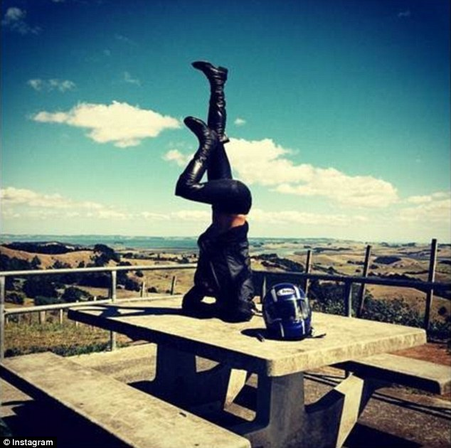 Michelle Rodriguez took time out of her cross country motorcycle trip in New Zealand to do a quick headstand