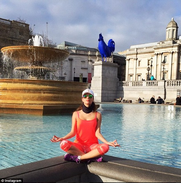 Playing tourist! Nicole Scherzinger took time for a quick meditative pose while in London's Trafalgar Square