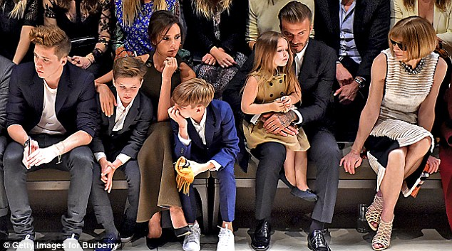 The Beckham family sit alongside editor-in-chief of American Vogue Anna Wintour at the Burberry 'London in Los Angeles' event at Griffith Observatory this week