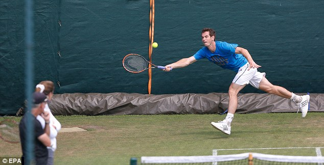 Putting the work in: Murray prepares for his fourth round match on the practice courts