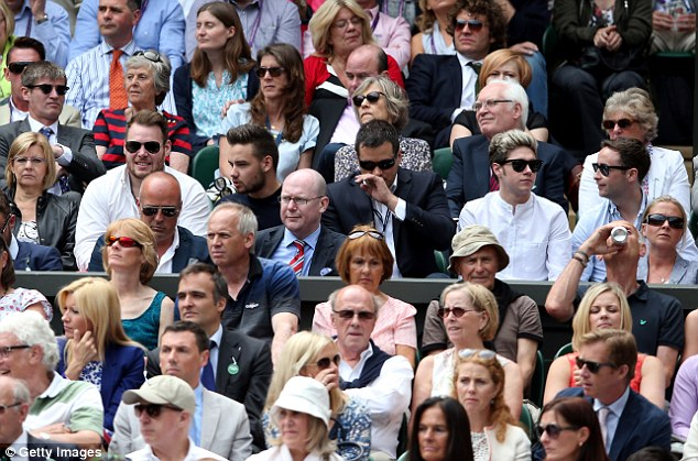 Star status: Niall Horan (second right) and Liam Payne (third left) of One Direction attend Wimbledon