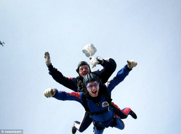 The teen smiles during a sky dive, done in aid of the charity - who he says changed his life