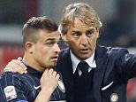 Inter Milan's coach Roberto Mancini (R) gives instruction to Xherdan Shaqiri during their Serie A soccer match against AC Milan at the San Siro stadium in Milan April 19, 2015.   REUTERS/Stefano Rellandini