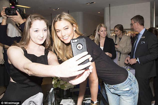 Selfie time! The beauty of course posed for pictures with those who had come to see her and her denim collection