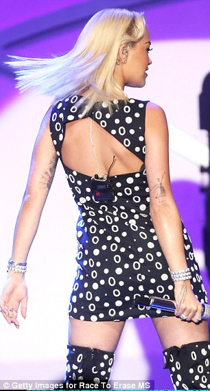 Stage presence: The blonde showed some skin in the backless number which featured an ultra short skirt