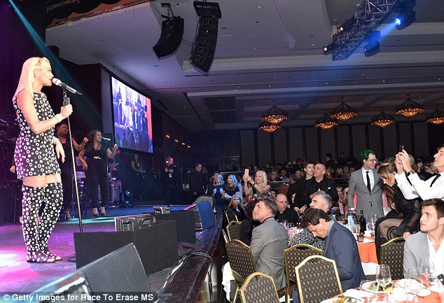 What a crowd: Rita's boyfriend Ricky, with the green hair, could be seen proudly watching his girlfriend's performance at Friday's charity event