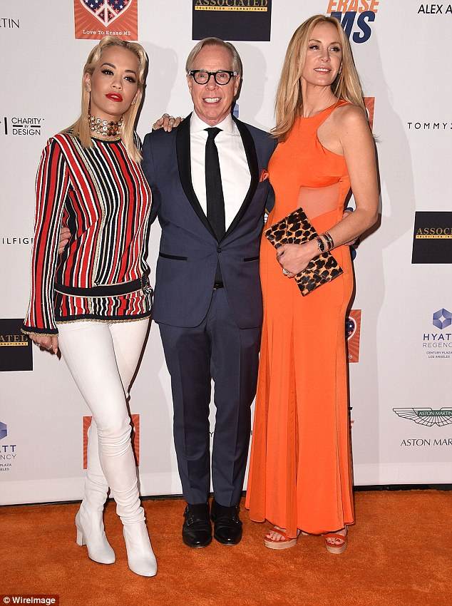 Part of the family: Rita posed with Tommy and his wife Dee Ocleppo on the orange carpet