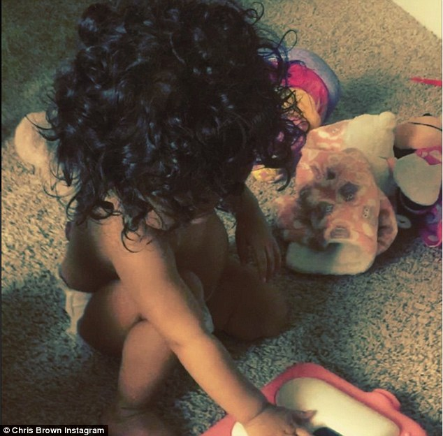 Curly girl! Royalty showed off her full head of flowing hair in the short clip