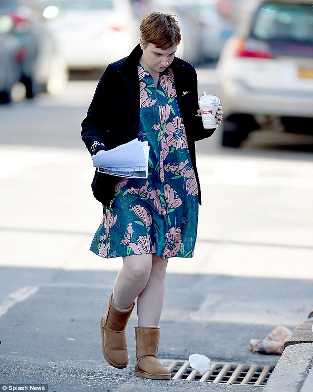 Staying warm: The actress covered up her brightly colored, floral dress with a monogrammed black jacket