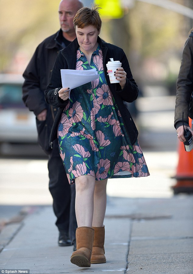 Preparing: Lena appeared to be reading a script as she walked to set to film for the HBO hit, which is due to return in 2016
