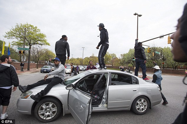 Two arrests: Demonstrators block Martin Luther King Boulevard as they march to the Western District Police Station to protest the death of Freddie Gray in Baltimore on Thursday. As evening turned into night on Thursday, two protesters had been arrested for disorderly conduct