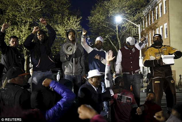 Tensions: Protesters gathered in front of the Baltimore Police Department Western District station