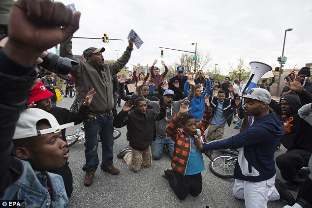 Demonstrators block Martin Luther King Boulevard as they marched through Baltimore on Thursday