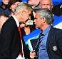 Football manager Arsene Wenger of Arsenal and Jose Mourinho, football manager of Chelsea clash during the Barclays Premier League match between Chelsea and Arsenal at Stamford Bridge in London, England.    LONDON, ENGLAND - OCTOBER 05:   (Photo by Shaun Botterill/Getty Images)