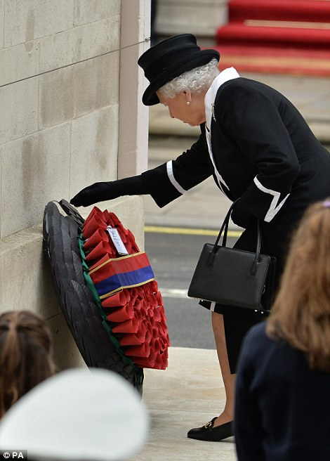 The head of state placed the first wreath near the base of the Cenotaph and she paused for a moment to bow her head before making her way back to her place