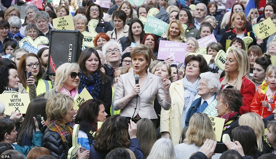 Rally: As the Cenotaph ceremony came to an end in London, the absent Ms Sturgeon was pictured with female activists launching the SNP's women's pledge in Buchanan Street, Glasgow
