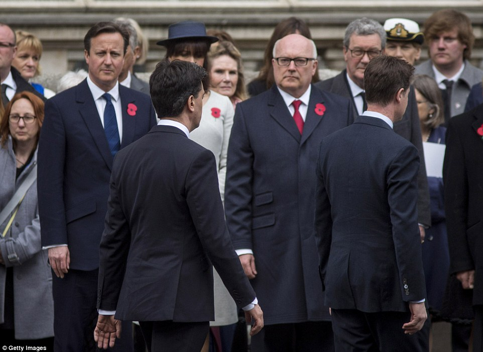 The Prime Minister looks on as Deputy Prime Minister Nick Clegg and Leader of the Opposition Ed Miliband walk by during the ceremony