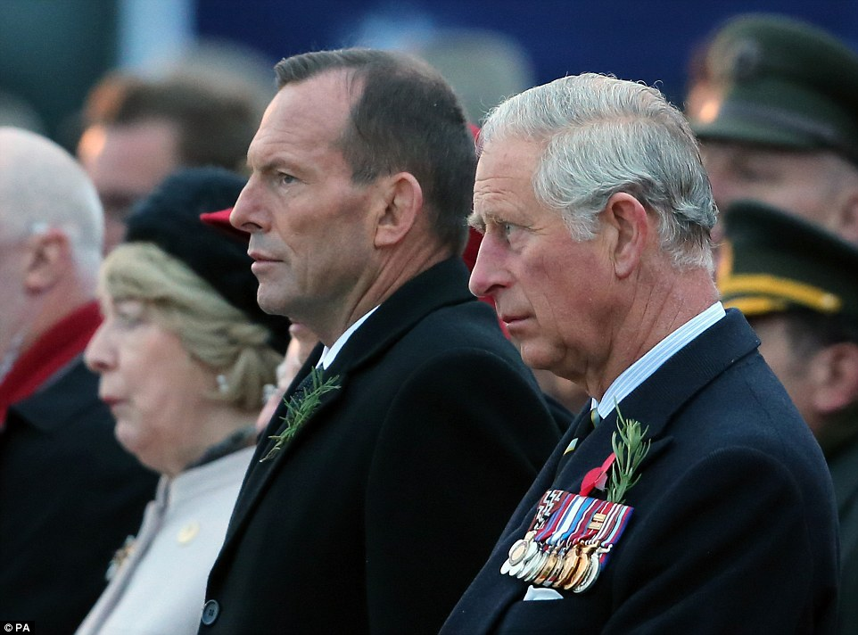 ANZAC day commemorations: Australian Prime Minister Tony Abbott, left, and the Prince of Wales watch this morning's ceremony