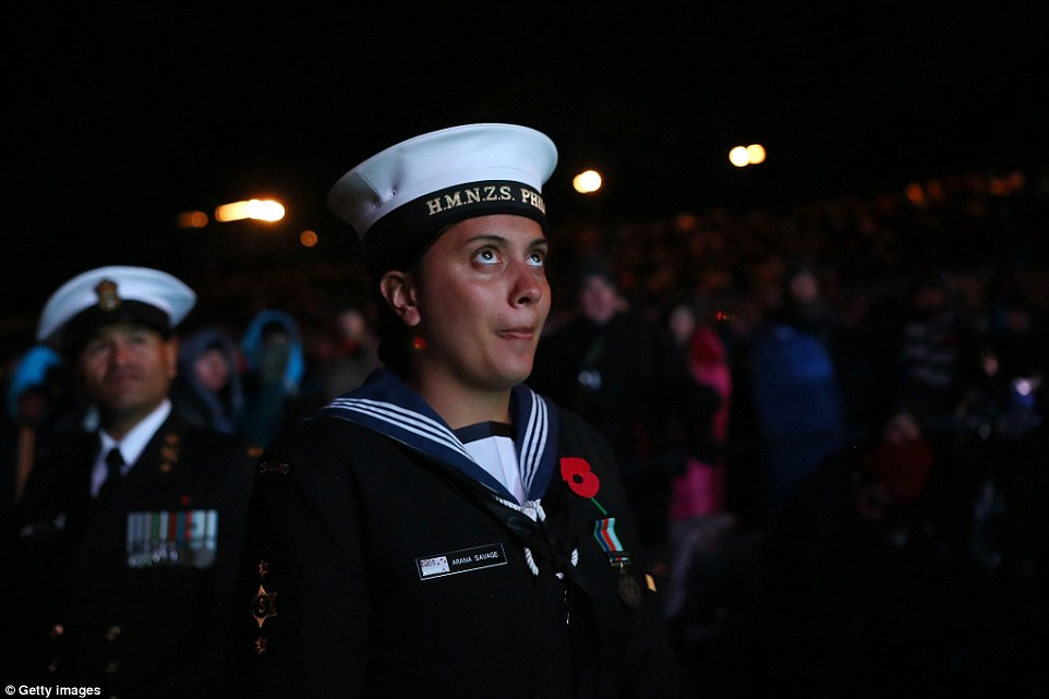Remembering dead: A female member of New Zealand's armed forces prepares for first light to break over the Gallipoli peninsula this morning