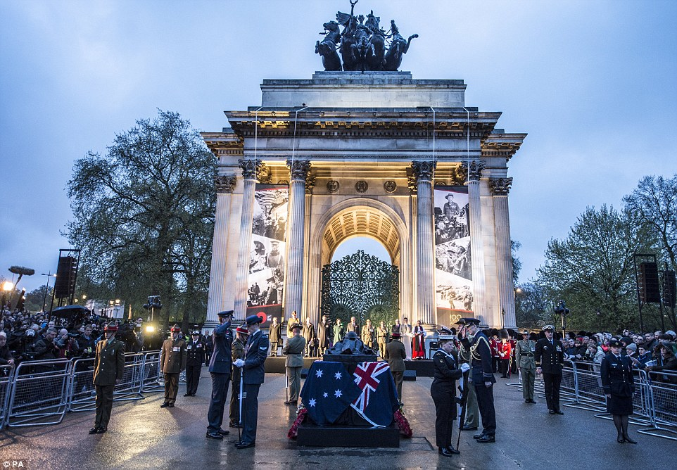 UK ceremony: Thousands of people also gathered at Wellington Arch in London this morning to mark ANZAC day
