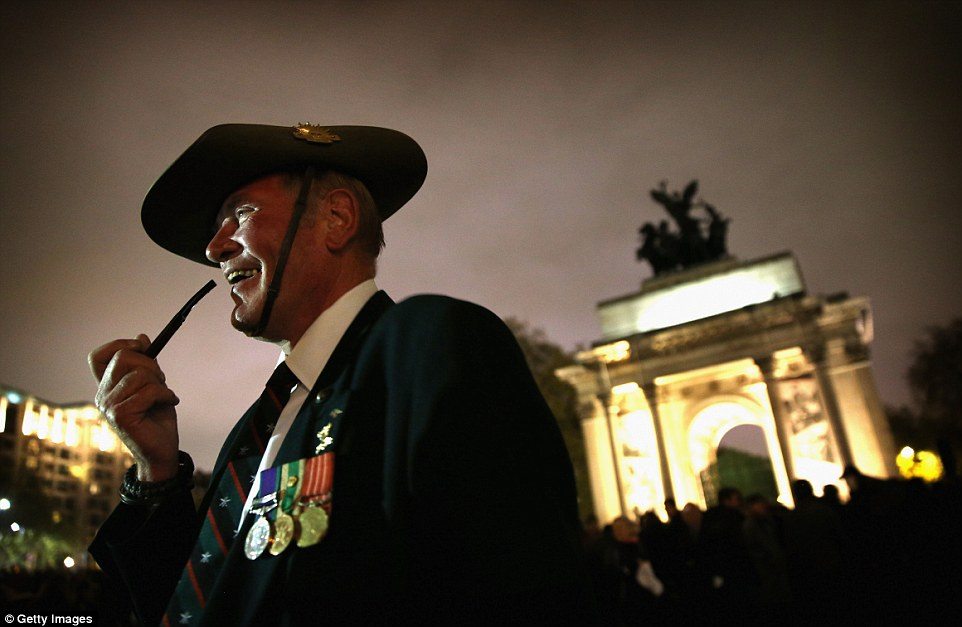 Major John Titley of 3 Royal Australian Regiment smokes his pipe as he waits for the early mornings ervice to start at Wellington Arch