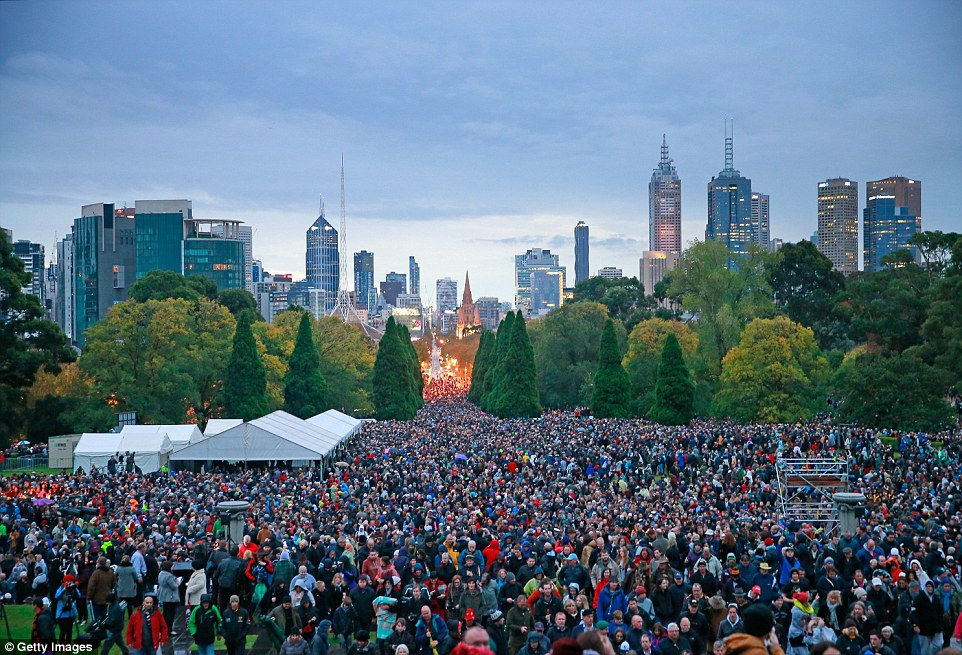 Spectacle: Thousands gathered for the 2015 Dawn Service on ANZAC Day at the Shrine of Remembrance in Melbourne today